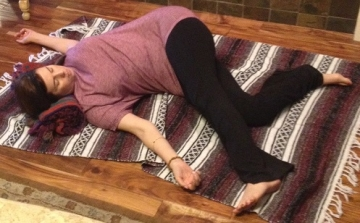 Restorative Pose Of The Month - Supine Revolved Triangle